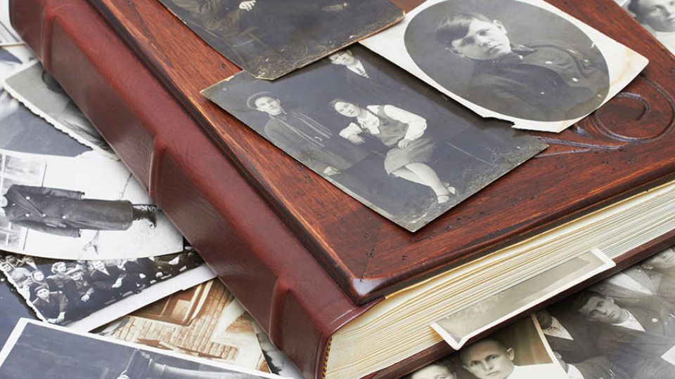 Closeup of a pile of vintage family photos.