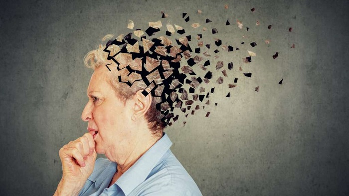 Senior Woman losing parts of head as symbol of decreased mind function.